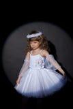 Portrait of adorable angel on dark background Stock Photo