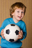 Portrait of adorable baby with a ball. Royalty Free Stock Images