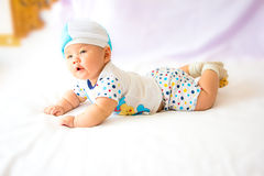 Portrait of adorable baby on the bed in my room Royalty Free Stock Images