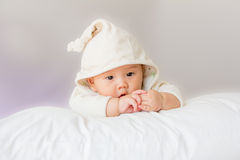 Portrait of adorable baby on the bed in my room Stock Image