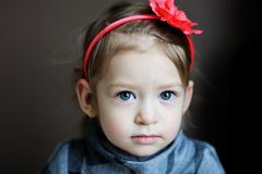 Portrait of adorable baby with flower headband Royalty Free Stock Photography