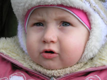 Portrait of an Adorable Baby Girl. A close up portrait of an adorable baby girl all dressed up in a pink winter coat and hat.  Photographer's daughter Royalty Free Stock Images
