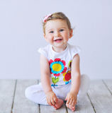 Portrait of an adorable baby girl. Beautiful baby girl smiling happily Royalty Free Stock Photo