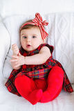 Portrait of an adorable baby girl. Beautiful baby wearing red headband bow top view Stock Photo