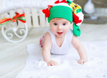Portrait of an adorable baby girl. Cute baby girl in Christmas stocking on her head Stock Photos