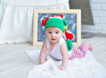 Portrait of an adorable baby girl. Cute baby girl in Christmas stocking on her head Royalty Free Stock Photos