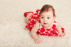 Portrait adorable baby girl. On fur Royalty Free Stock Photography