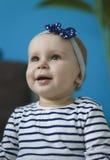 Portrait of adorable baby. Girl with headband Stock Photos