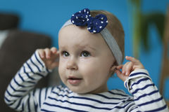 Portrait of adorable baby. Girl with headband Stock Images