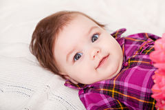 Portrait adorable baby girl. Looking at camera Royalty Free Stock Photos