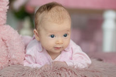 Portrait of adorable baby girl in pink dress.  Stock Image