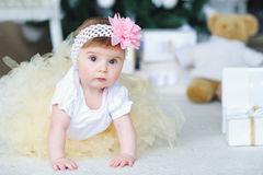 Portrait of an adorable baby girl. Adorable smiling baby girl crawling Stock Image