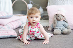 Portrait of an adorable baby girl. Adorable smiling baby girl crawling Royalty Free Stock Photography