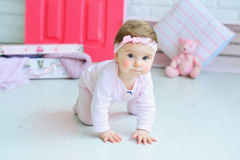 Portrait of an adorable baby girl. Adorable smiling baby girl crawling Royalty Free Stock Images