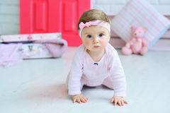 Portrait of an adorable baby girl. Adorable smiling baby girl crawling Stock Images