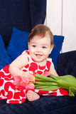 Portrait adorable baby girl. With spring flowers Stock Photos