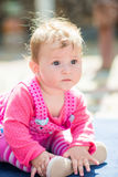 Portrait of adorable baby girl. On a summer sunny day. Outdoor portrait of baby girl Stock Photography