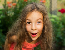 portrait of Little girl is surprised and so. Portrait of Little girl in red dress is surprised and  shocked andso happy Royalty Free Stock Image