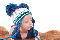 Portrait of adorable baby in knitted hat Stock Images
