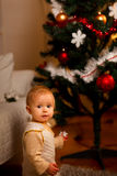 Portrait of adorable baby near Christmas tree Royalty Free Stock Photos