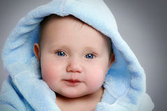 Portrait of a adorable baby in soft blue hod Royalty Free Stock Image