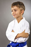 Portrait of an adorable boy in kimono with arms folded Stock Images