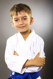 Portrait of an adorable boy in kimono with arms folded Stock Photo