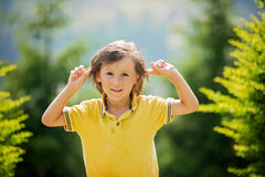 Portrait of adorable boy, making funny faces stock photography