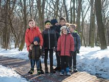 Portrait of adorable boys in winter park stock photography