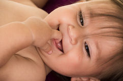 Portrait of adorable brunette baby girl Stock Photos