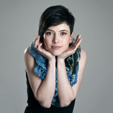 Portrait of adorable charming short hair girl with head resting in hands Royalty Free Stock Image