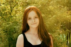 Teenage girl with wonderful long brown hair and freckles, retro Royalty Free Stock Image