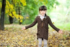 Portrait of adorable child girl in autumn forest Royalty Free Stock Image
