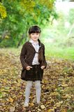 Portrait of adorable child girl in autumn forest Royalty Free Stock Photography