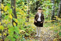Portrait of adorable child girl in autumn forest Stock Image