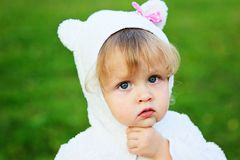 Portrait of adorable child girl playing outdoors Royalty Free Stock Image
