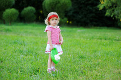 Portrait of adorable child girl playing outdoors Stock Photos