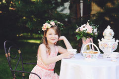 Portrait of adorable child girl at tea table Royalty Free Stock Photography