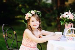 Portrait of adorable child girl at tea table Stock Image