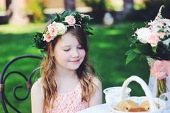 Portrait of adorable child girl at tea table Royalty Free Stock Photos