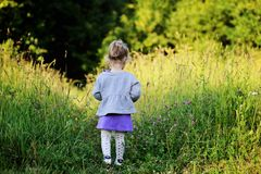 Portrait of adorable child girl walking outdoors Royalty Free Stock Photography