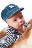 Portrait of adorable child in hat lying on fur Royalty Free Stock Image