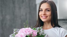 Portrait of adorable cute lady with perfect skin posing holding tender rose and herb flavor closeup