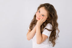 Portrait of adorable dreaming little girl isolated on a white Stock Images