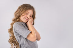 Portrait of adorable dreaming little girl isolated on a white Stock Photo