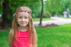 Portrait of adorable funny little girl on summer Stock Photo