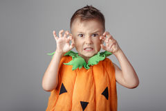 funny white Caucasian boy dressed as pumpkin for Halloween Royalty Free Stock Photo