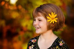Portrait of happy adorable girl with flower in her hairs royalty free stock images