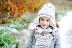 Portrait of adorable girl outdoor in winter park Stock Photo