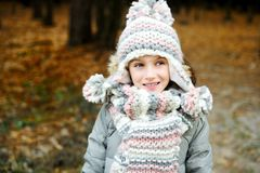 Portrait of adorable girl outdoor in winter park Stock Images